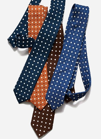 Instantly lift your workweek style this fall by tying on a 100% printed silk polka dot tie.