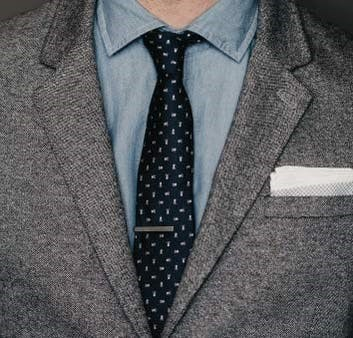 A person with coat, shirt and tie show how Tie Bar to help you dress better